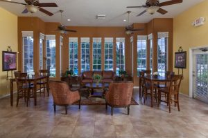 Lounge area with seating and ceiling fans